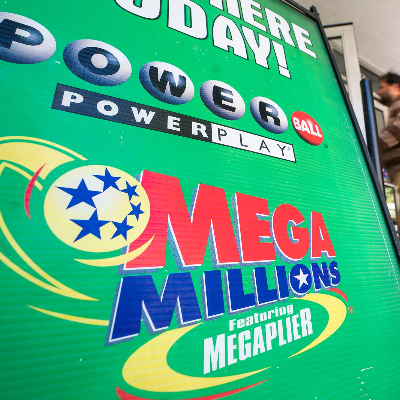 An advertisement for Mega Millions, a 44-state lottery with a record jackpot of nearly one billion US dollars, outside a grocery store in Washington, D.C., on Oct. 18, 2018. The jackpot for New Year's Day is $425 million.