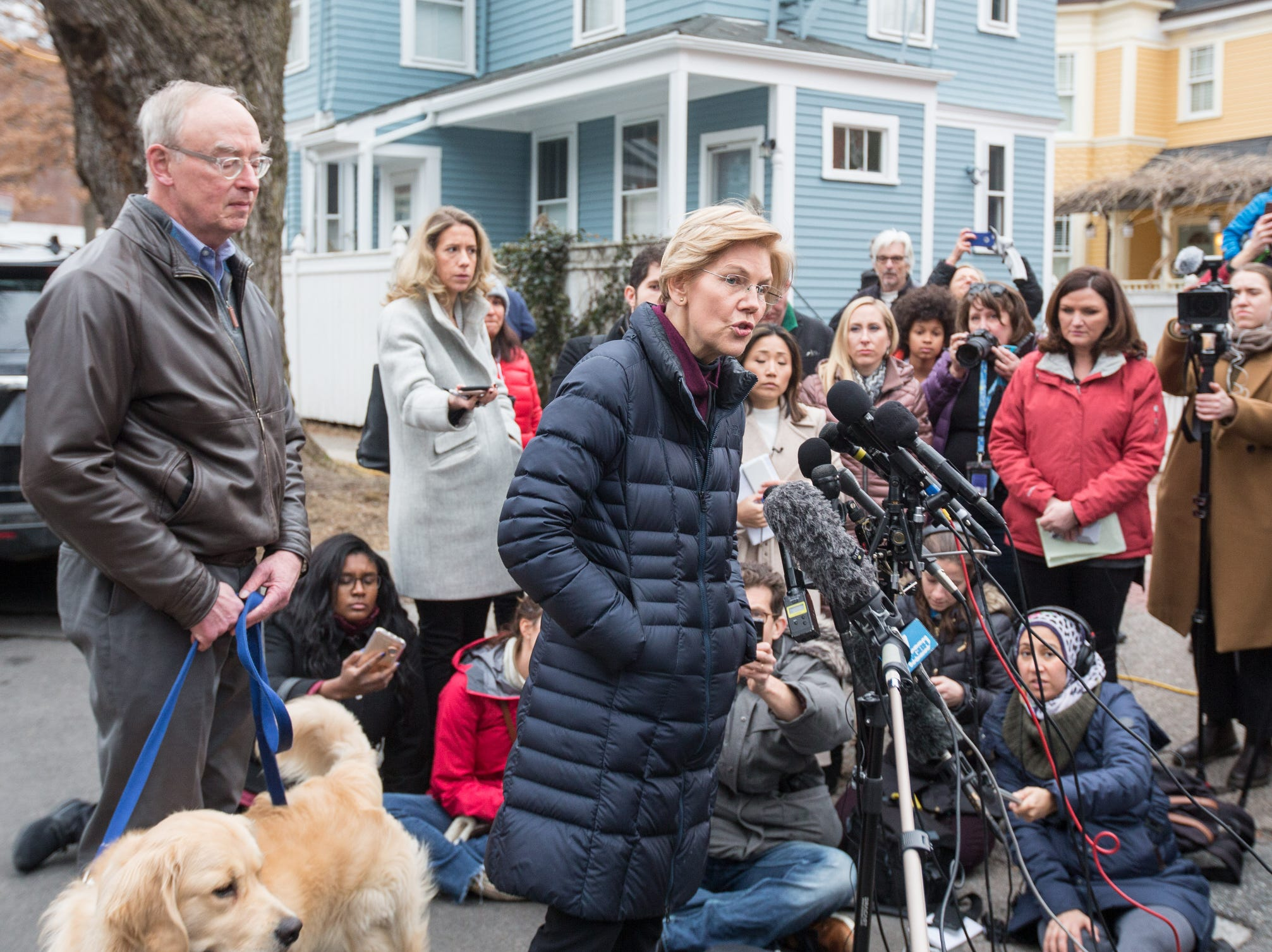 Sen. Elizabeth Warren (D-MA), addresses the media outside of her home in Cambridge, Mass. She is one of the earliest potential candidates to make an official announcement in what is expected to be a very large Democratic field.