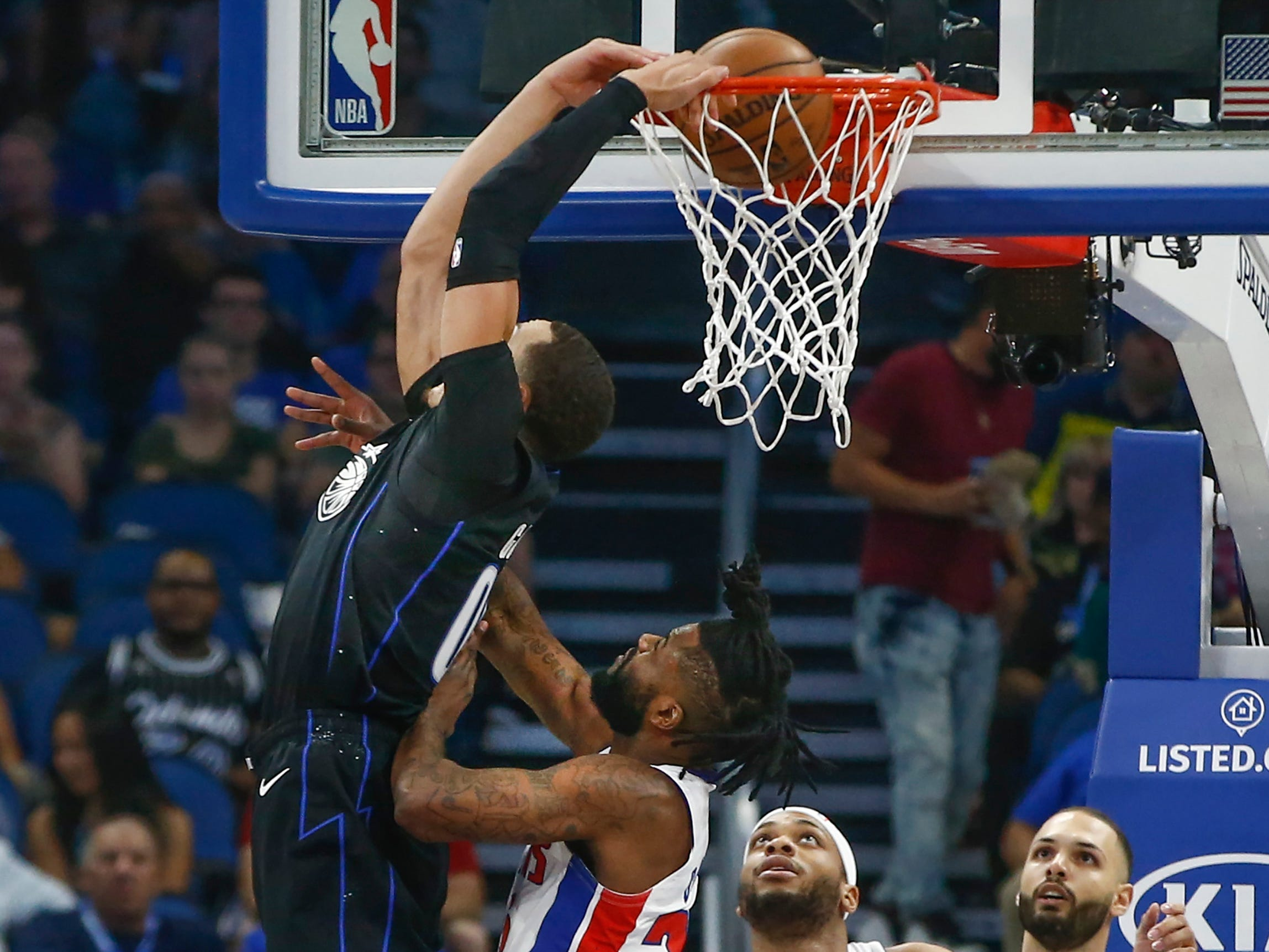 Dec. 30: Magic forward Aaron Gordon (00) draws the foul but still finishes the two-handed reverse against the Pistons.