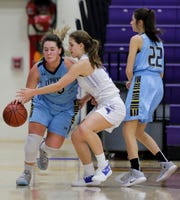 Amherst's Ashley Goshek (12) defends St Mary Catholic's Abbi Thelen, left, during the 47th annual Sentry Classic on Friday at Quandt Fieldhouse in Stevens Point.