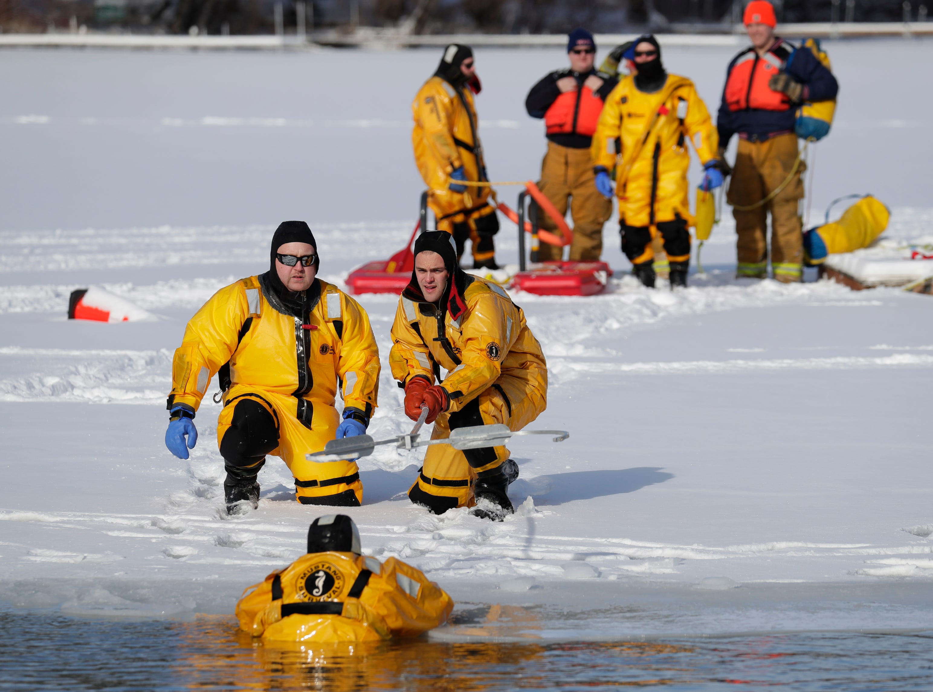 Waupaca firefighters conduct a water rescue demonstration during the Polar Bear Plunge Tuesday, January 1, 2019, at Becker Marine on Lime Kiln Lake in Waupaca, Wis. 