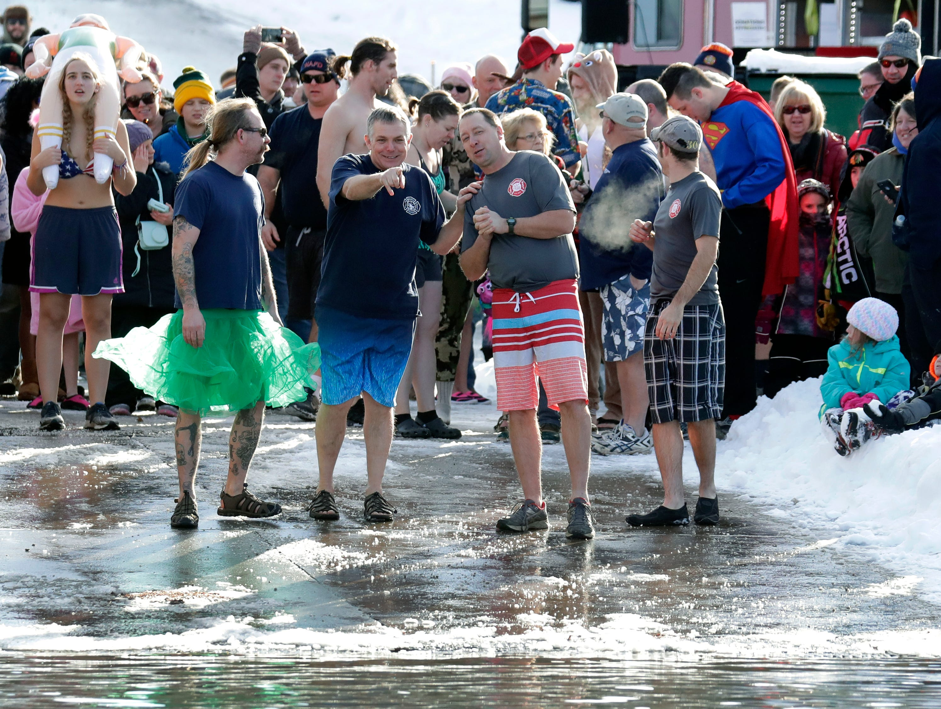 Participants wait for the countdown during the Polar Bear Plunge Tuesday, January 1, 2019, at Becker Marine on Lime Kiln Lake in Waupaca, Wis. 