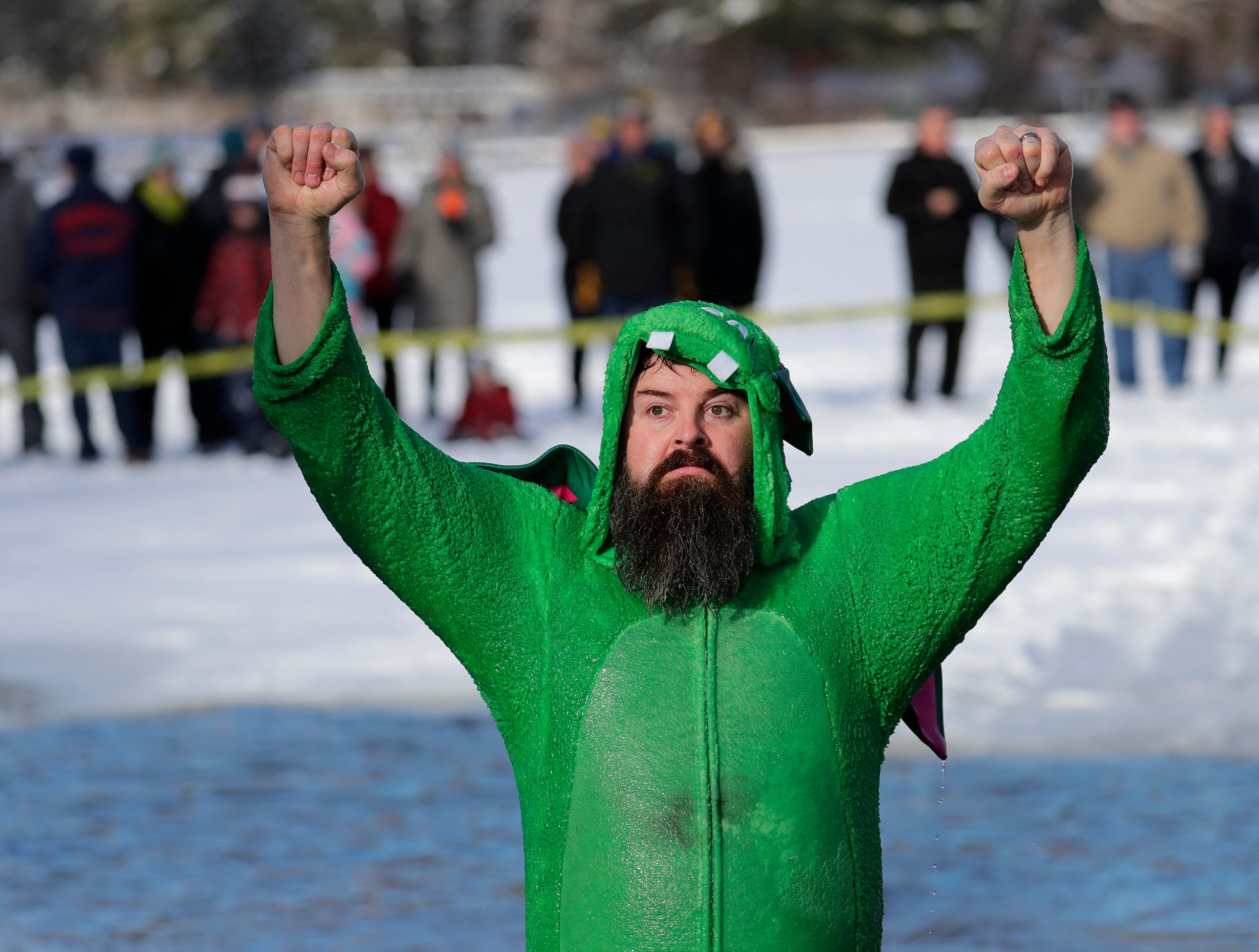 Danny Fili of Waupaca celebrates after jumping into frigid water during the Polar Bear Plunge Tuesday, January 1, 2019, at Becker Marine on Lime Kiln Lake in Waupaca, Wis. 