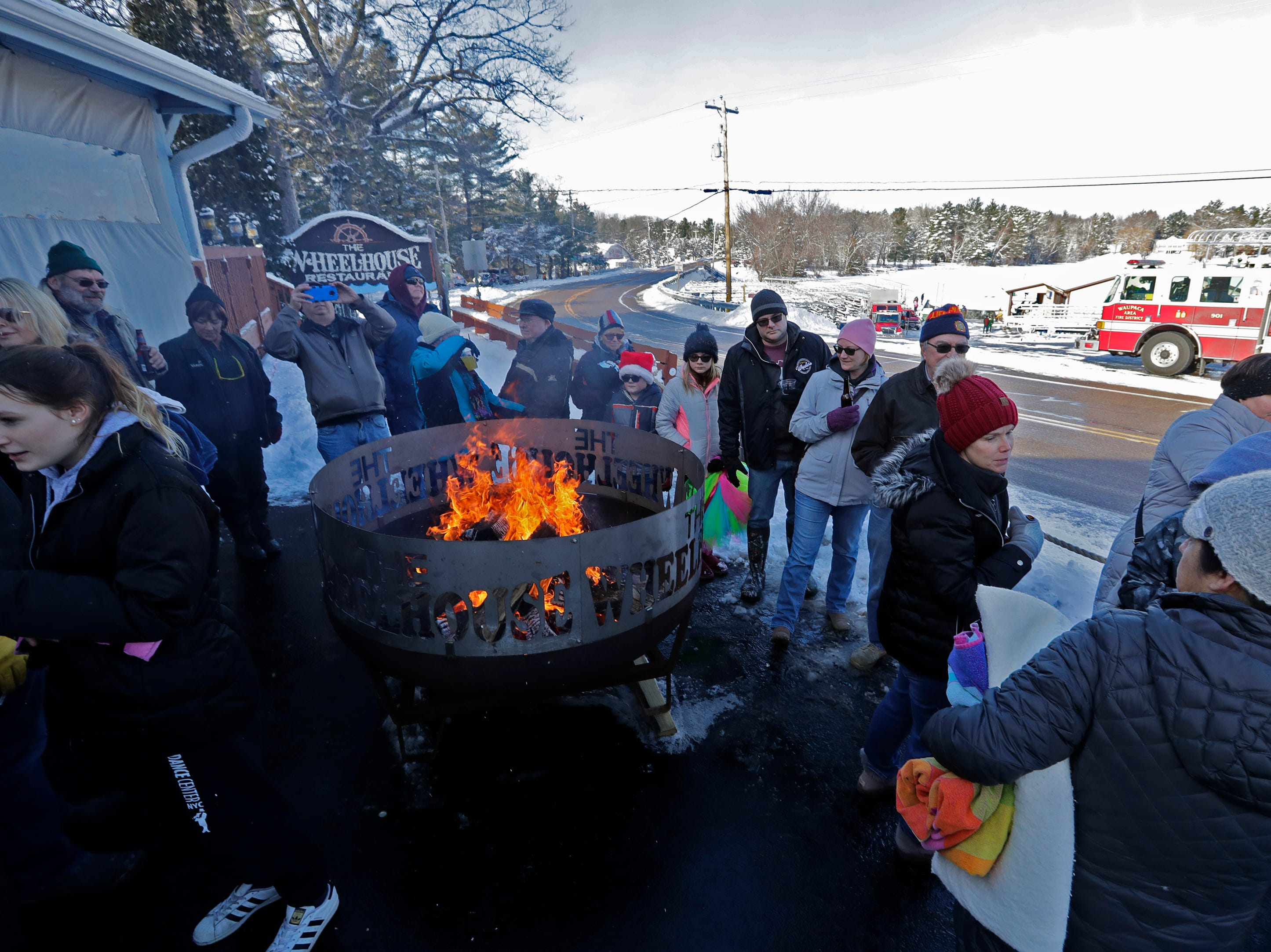 The Wheelhouse Restaurant is full of activity during the Polar Bear Plunge Tuesday, January 1, 2019, at Becker Marine on Lime Kiln Lake in Waupaca, Wis. Dan Powers/USA TODAY NETWORK-Wisconsin