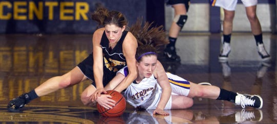 St. John Vianney's Jackie Kates and St. Rose's Kasey Chambers battle for a loose ball during closing minutes of game. St John Vianney Girls basketball vs St Rose - Peter Ackerman / APP - 01/22/10  #69036  gbbsrsj110122c