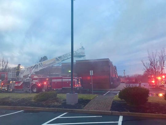 Fire crews respond to a fire at the Applebee's Bar & Grill in Howell on New Year's Day.
