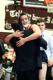 Alex Sebahie, Paramus, in white celebrates with his coach at the 2014 District 5 wrestling tournament at Don Bosco in Ramsey.