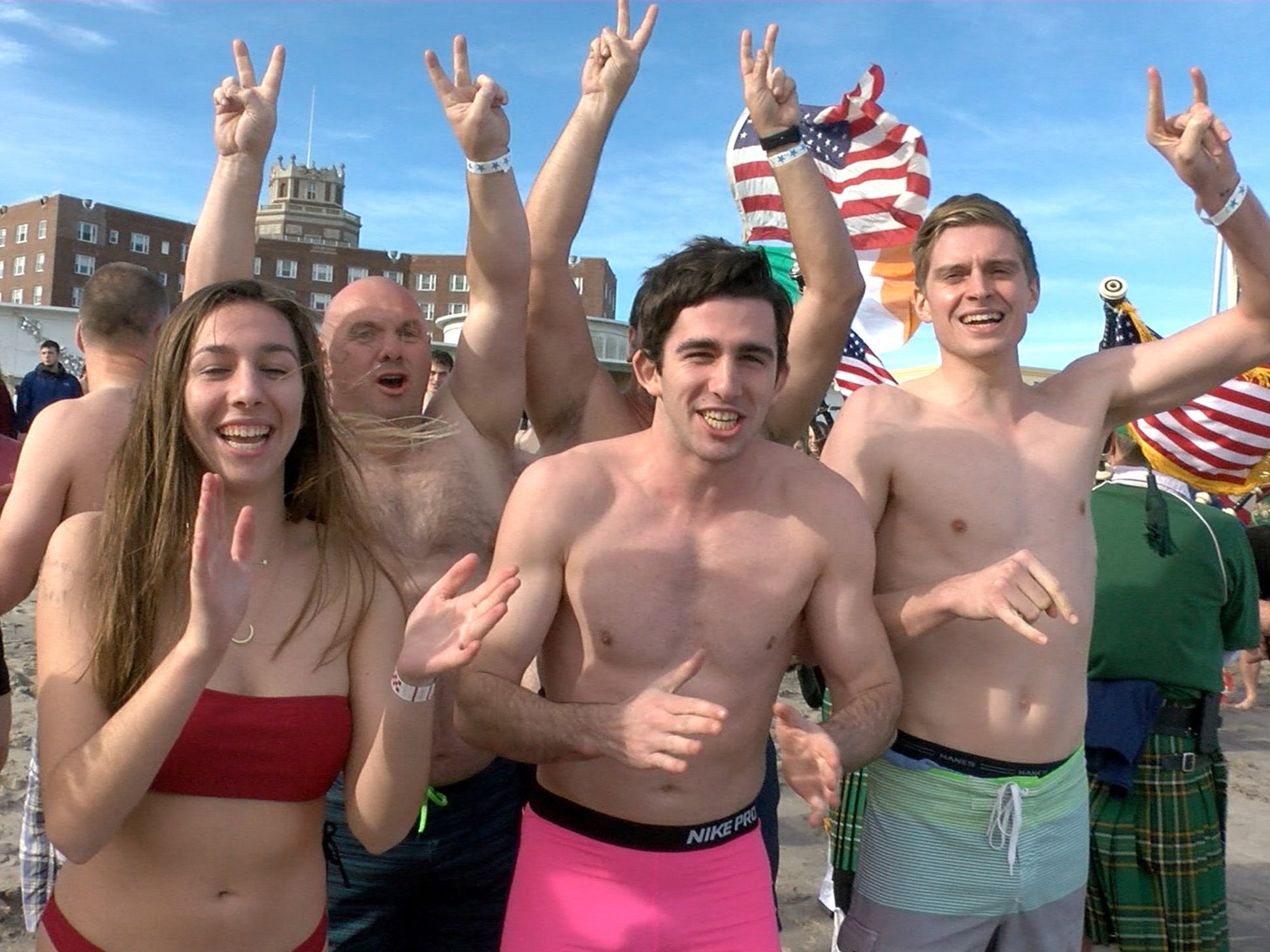 People get excited for their New Years Day dip in the ocean off Asbury Park during the Sons of Ireland Polar Plunge Tuesday, January 1, 2019.