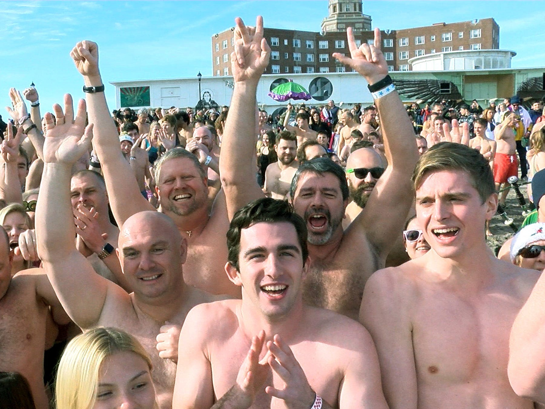People fill the beach before their New Years Day dip in the ocean off Asbury Park during the Sons of Ireland Polar Plunge Tuesday, January 1, 2019.