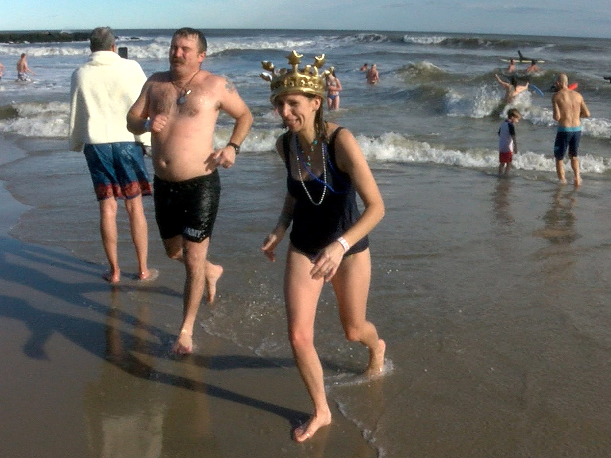 Mandy Hanigan, Red Bank, returns to shore after taking her New Years Day dip in the ocean off Asbury Park during the Sons of Ireland Polar Plunge Tuesday, January 1, 2019.