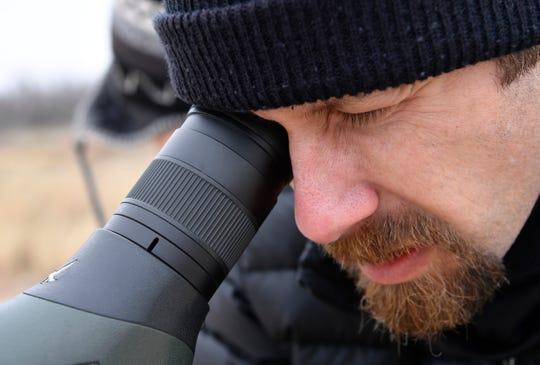 Jay Packer identifies a bird using a telescope Tuesday at Kirby Lake.