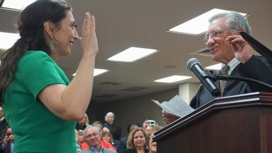 Barbara Canales takes the oath of office for Nueces County Judge from Senior United States District Judge Hayden W. Head Jr. on Jan. 1, 2019.