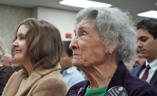 Elvira Garcia, 95, and Jacqueline Black, 19, watch as Barbara Canales is sworn in as the first female Nueces County Judge on Jan. 1, 2019. Garcia is Canales' grandmother, while Black is Canales' daughter.