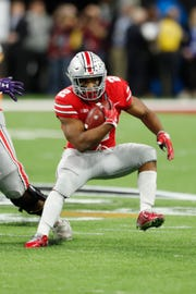 Ohio State running back J.K. Dobbins runs with the ball against Northwestern during the fourth quarter in the Big Ten conference championship game.