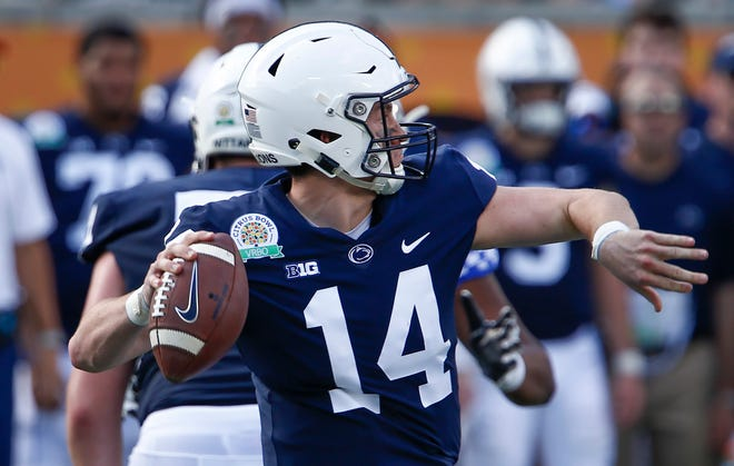 Penn State Nittany Lions quarterback Sean Clifford (14) throws the ball against the Kentucky Wildcats during the second quarter in the 2019 Citrus Bowl at Camping World Stadium.