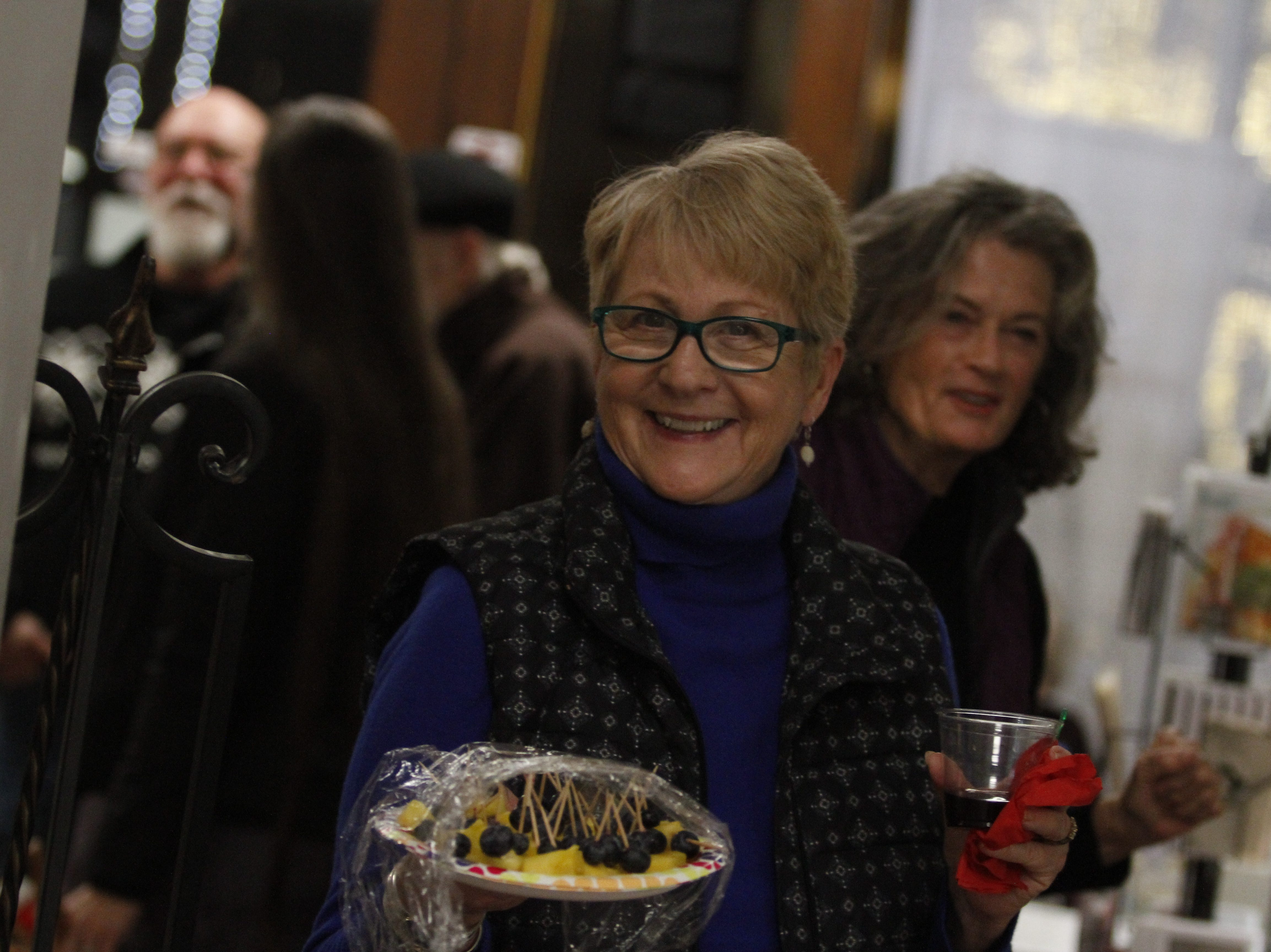 Jane Diehr smiles during the New Year's Eve party at the Downtown Artists Co-op, Dec. 31, 2018, in Clarksville, Tenn.
