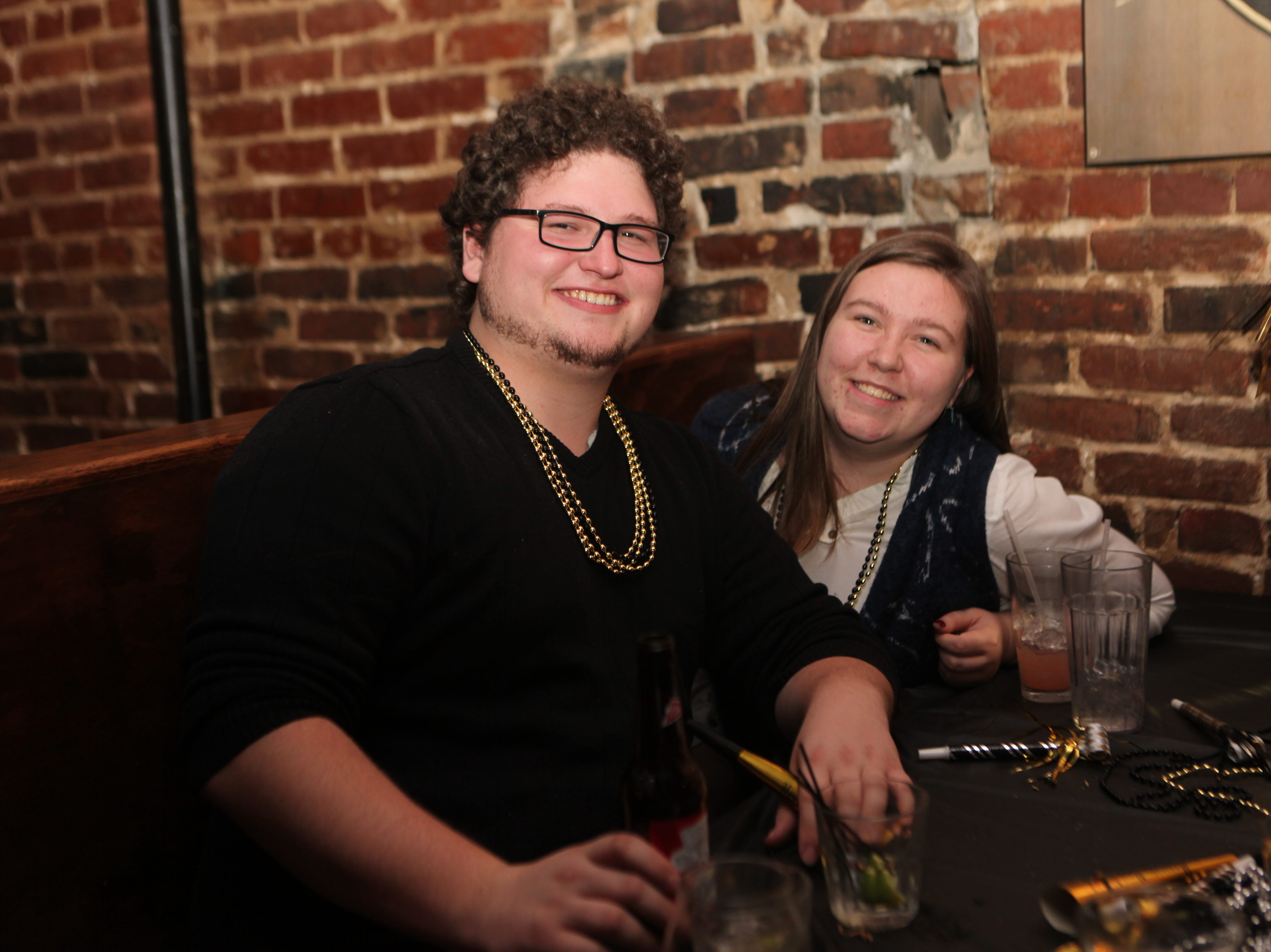 People gather for the Tap Room's New Year's Eve Party, Dec. 31, 2018, in Clarksville, Tenn.