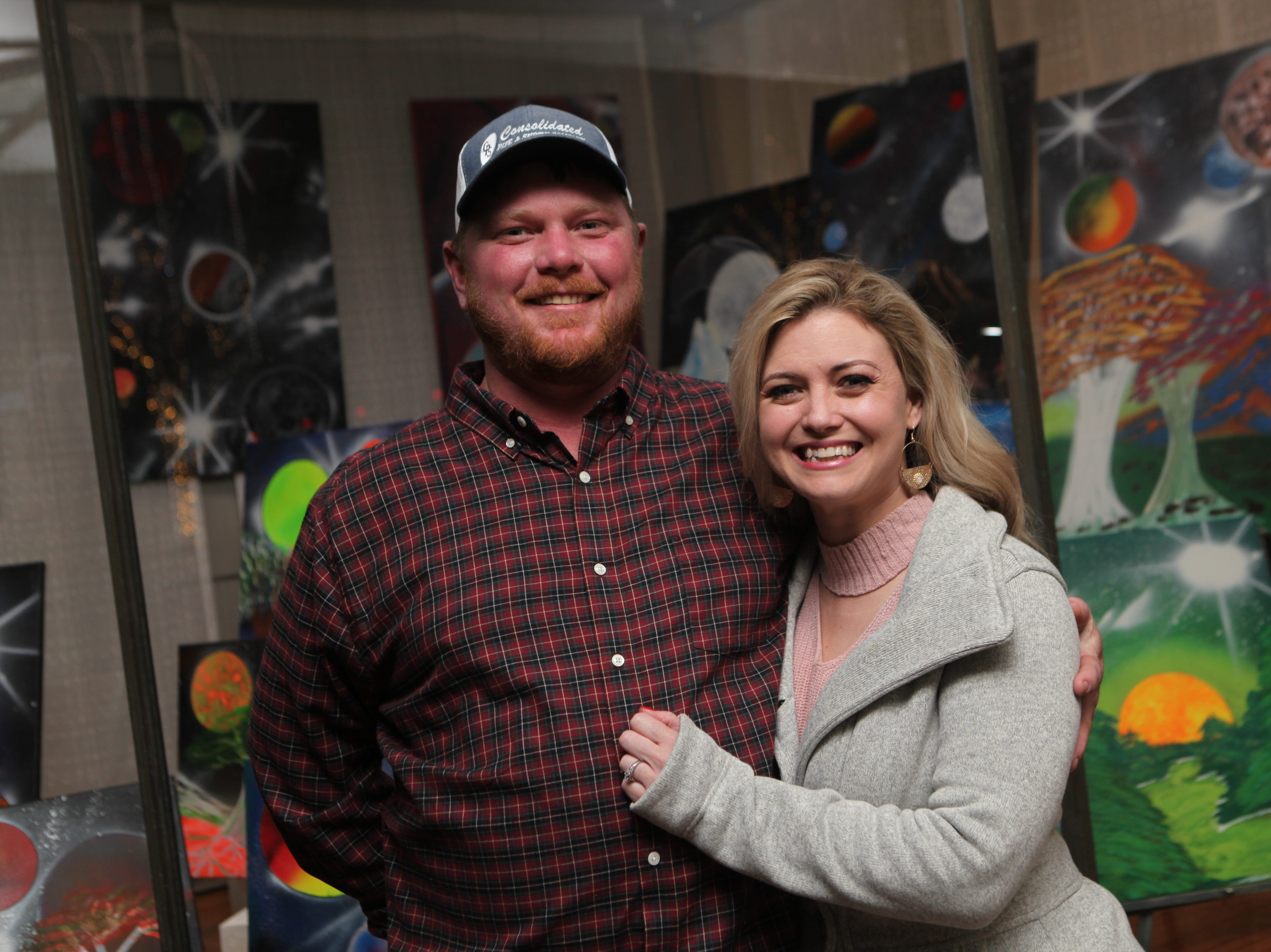 Matt Maloney and Regina Mick enjoy the artwork during the New Year's Eve party at the Downtown Artists Co-op, Dec. 31, 2018, in Clarksville, Tenn.