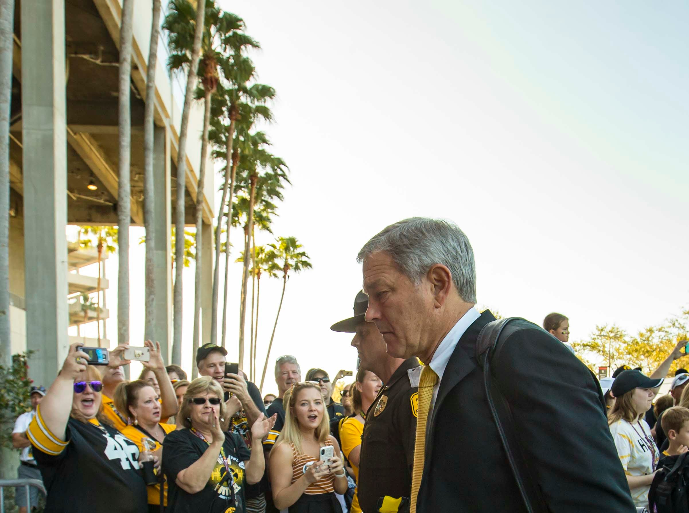 Coach Kirk Ferentz arrives with Iowa football team at Raymond James Stadium Jan. 1, 2019 in Tampa, Florida. Iowa takes on Mississippi State in the Outback Bowl.