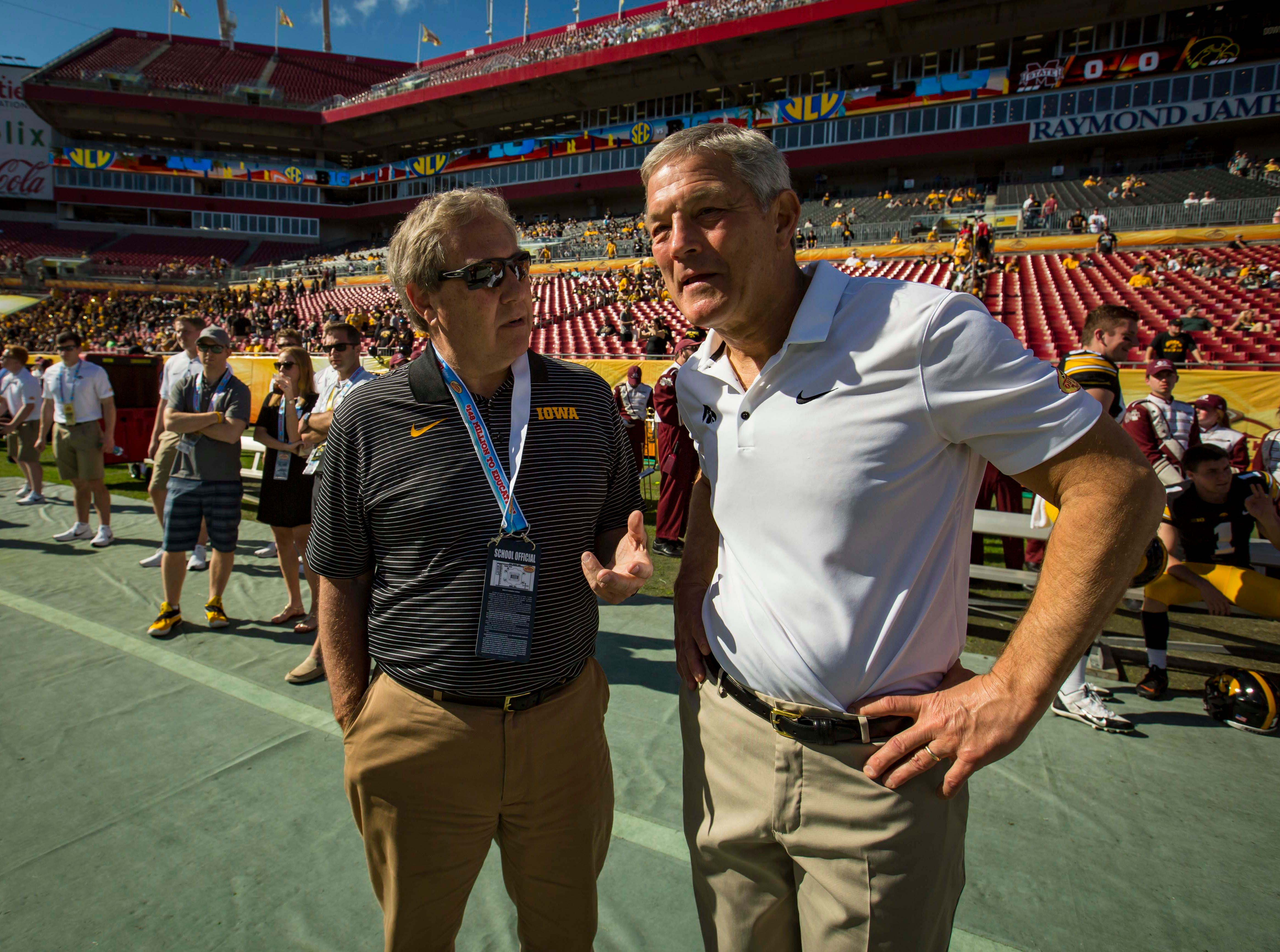Iowa coach Kirk Ferentz and UI President Bruce Harreld meet before the Outback Bowl Tues., Jan. 1, 2019, at Raymond James Stadium in Tampa, Florida.
