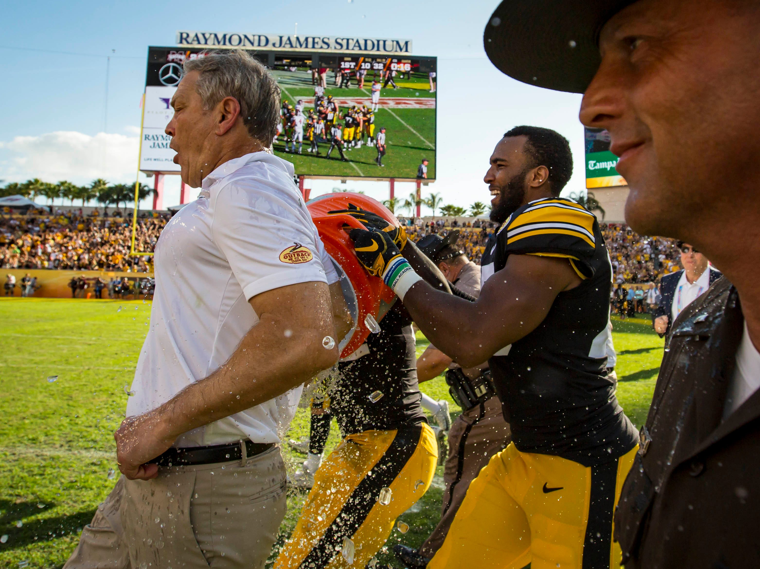 Head Coach Kirk Ferentz is spalsh with water after winning the Outback Bowl Tues., Jan. 1, 2019, at Raymond James Stadium in Tampa, Florida. Iowa defeated Mississippi State 27-22.