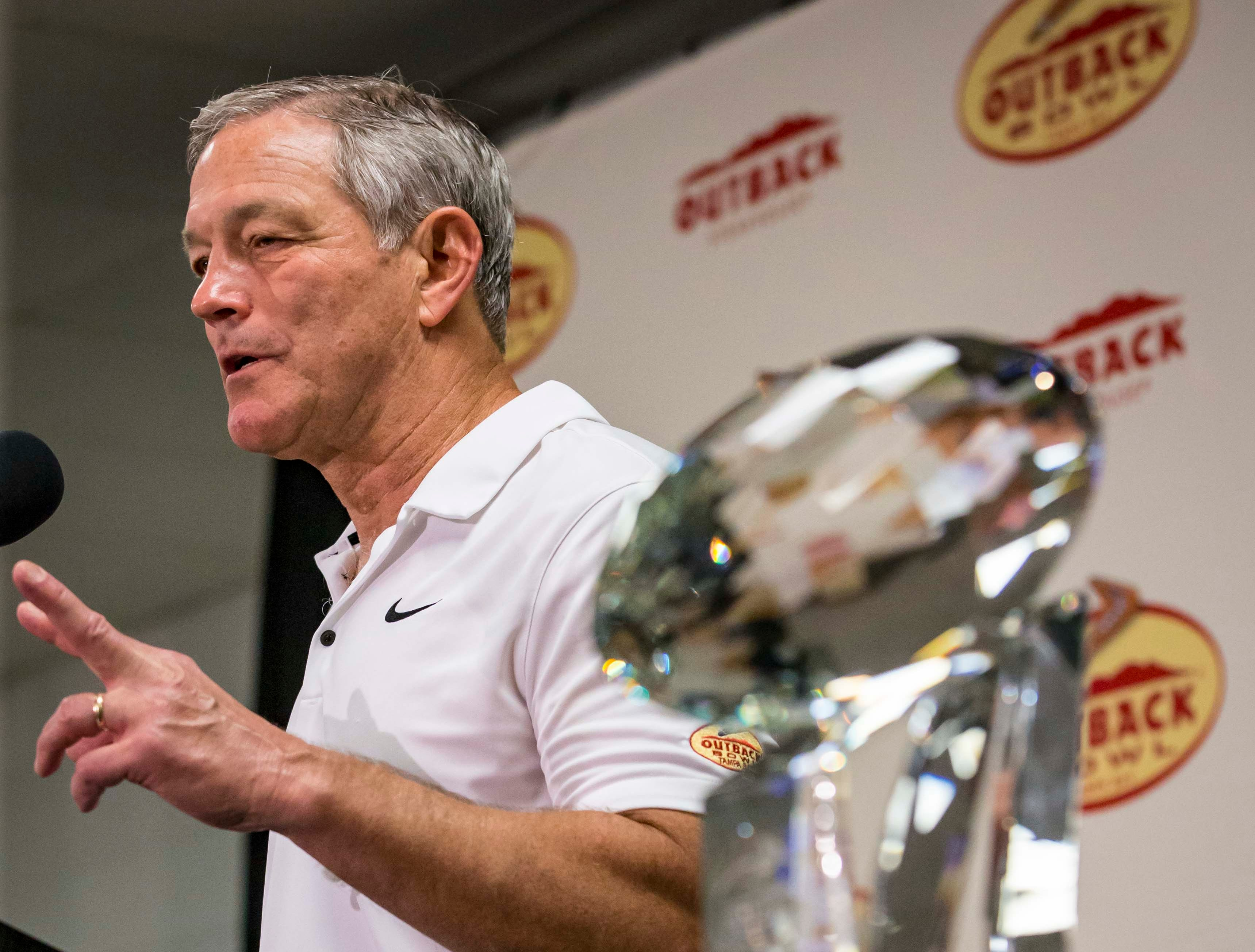Coach Kirk Ferentz talks to media with the winner's trophy after the Outback Bowl Tues., Jan. 1, 2019, at Raymond James Stadium in Tampa, Florida. Iowa defeated Mississippi State 27-22.