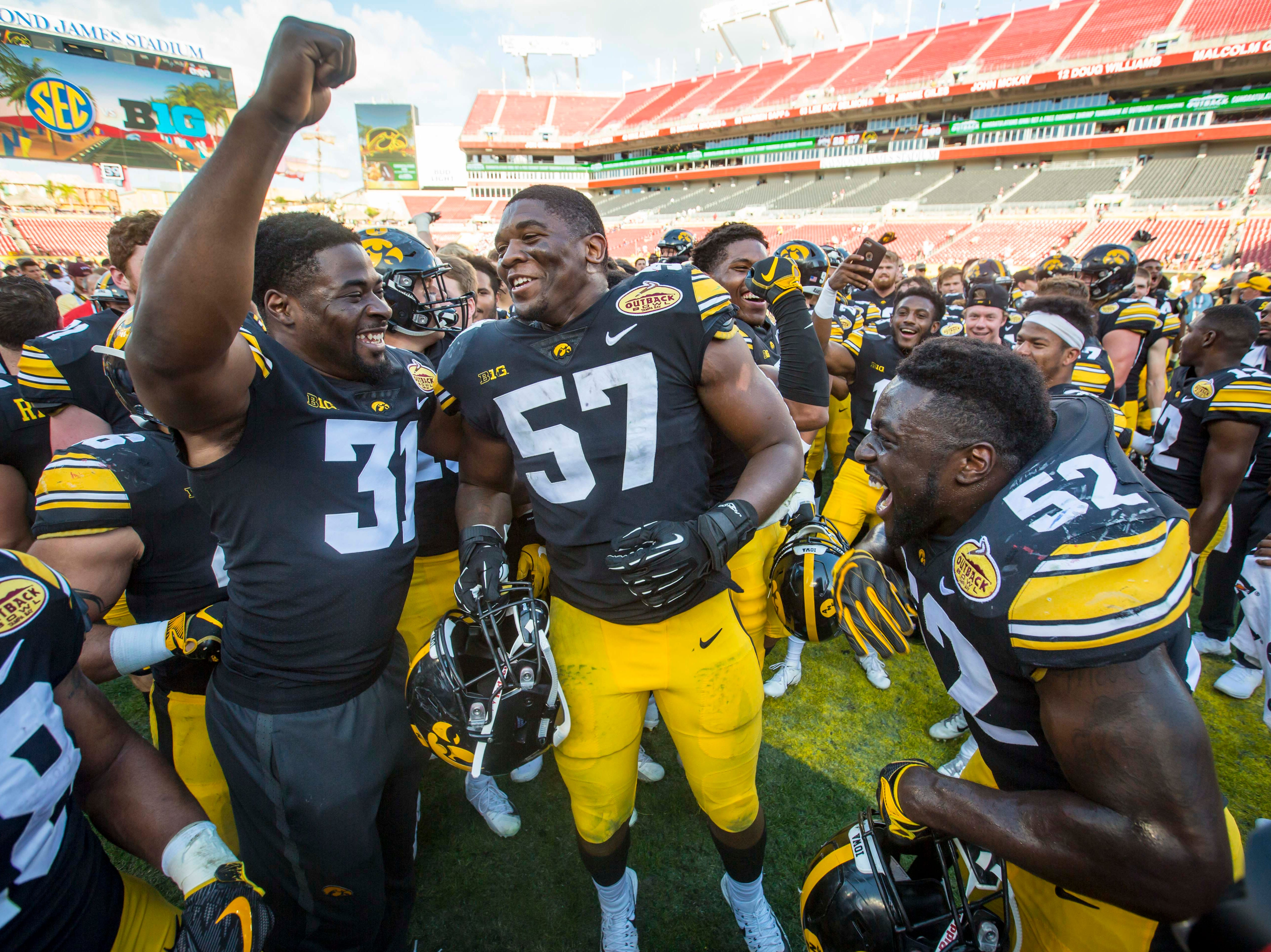 Iowa football players celebrate their victory over Mississippi State at the Outback Bowl Tues., Jan. 1, 2019, at Raymond James Stadium in Tampa, Florida. Iowa defeated Mississippi State 27-22.