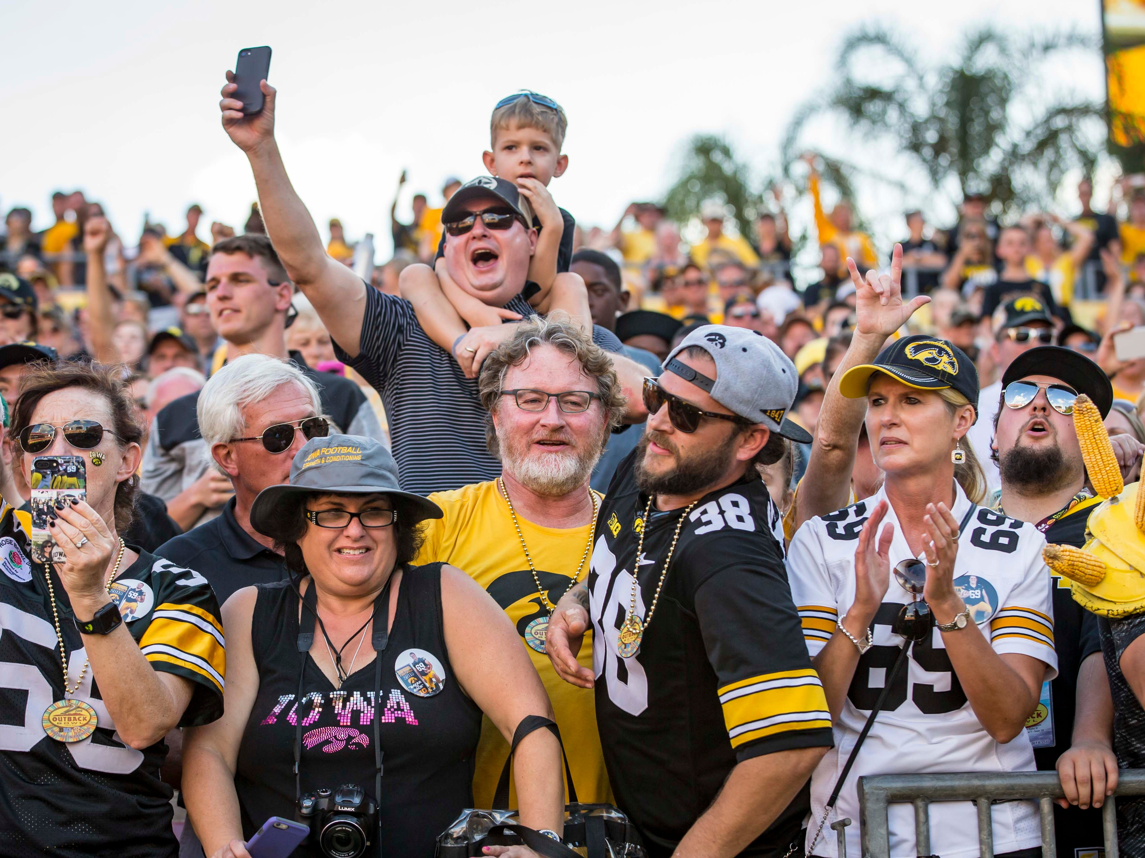 Fans celebrate in the second half at the Outback Bowl Tues., Jan. 1, 2019, at Raymond James Stadium in Tampa, Florida. Iowa defeated Mississippi State 27-22.