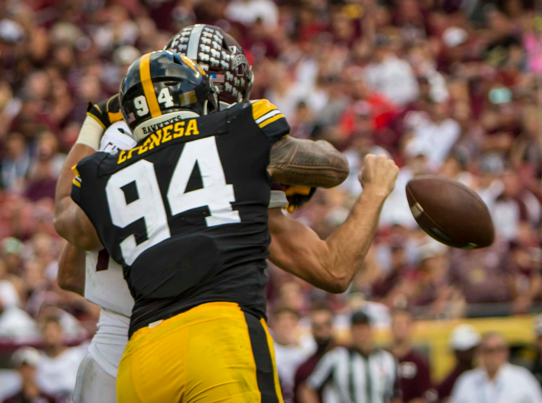 Iowa defensive end A.J. Epenesa sacks and forces a fumble on Mississippi State's quarterback Nick Fitzgerald in the first half at the  Outback Bowl Tues., Jan. 1, 2019, at Raymond James Stadium in Tampa, Florida. Iowa takes a 17-6 lead over Miss. St. into halftime.