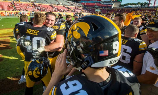 Iowa football players celebrate at the Outback Bowl Tues., Jan. 1, 2019, at Raymond James Stadium in Tampa, Florida. Iowa defeated Mississippi State 27-22.