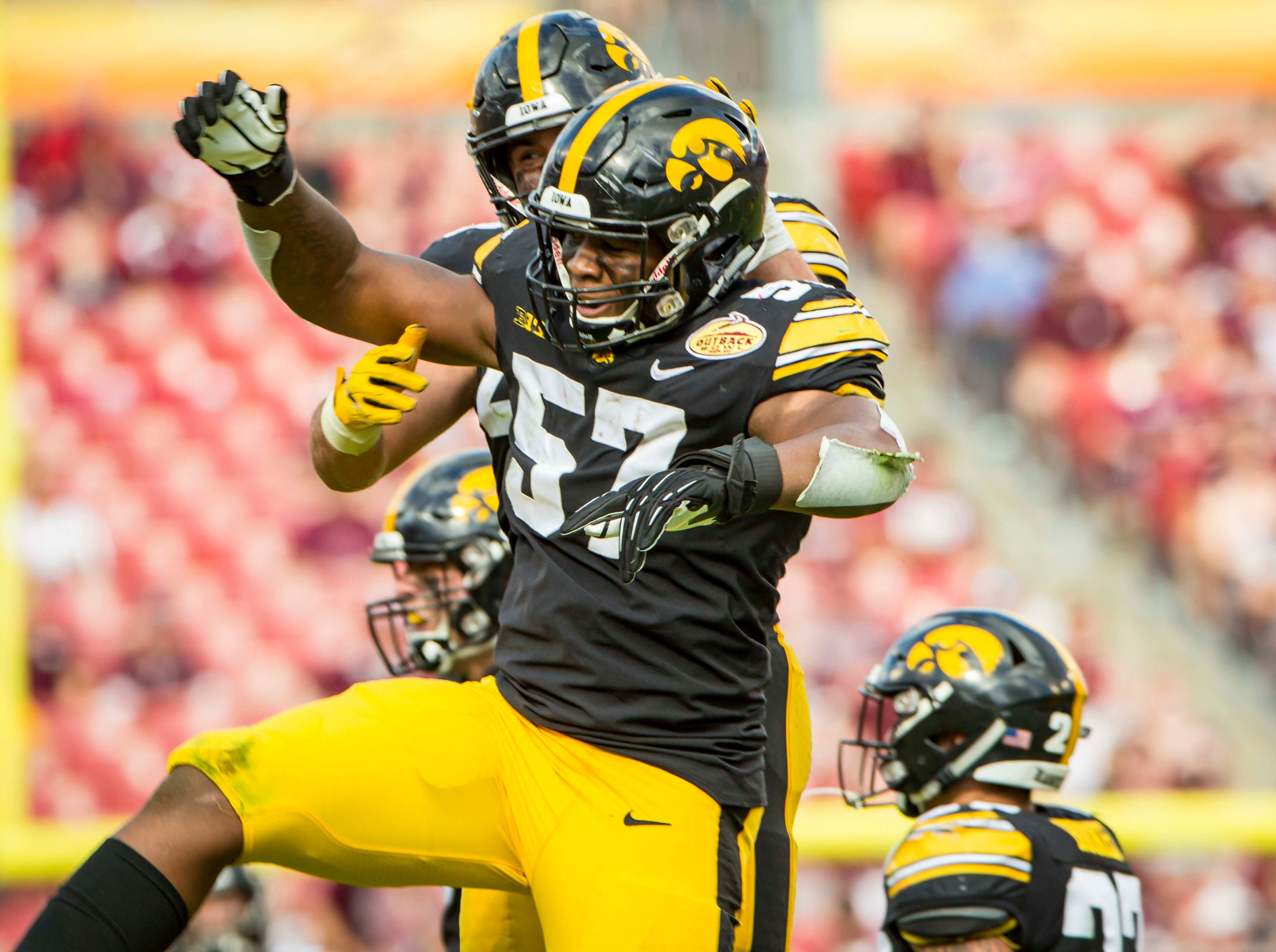 Iowa defensive end Chauncey Golston celebrates an interception in the second half at the Outback Bowl Tues., Jan. 1, 2019, at Raymond James Stadium in Tampa, Florida. Iowa defeated Mississippi State 27-22.