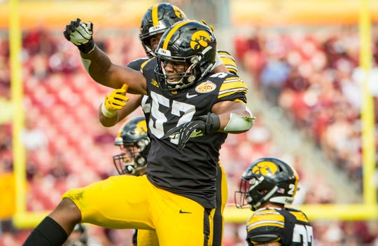 Iowa defensive end Chauncey Golston celebrates an interception in the second half against Mississippi State at the Outback Bowl. Iowa would score its go-ahead points following Golston's interception.