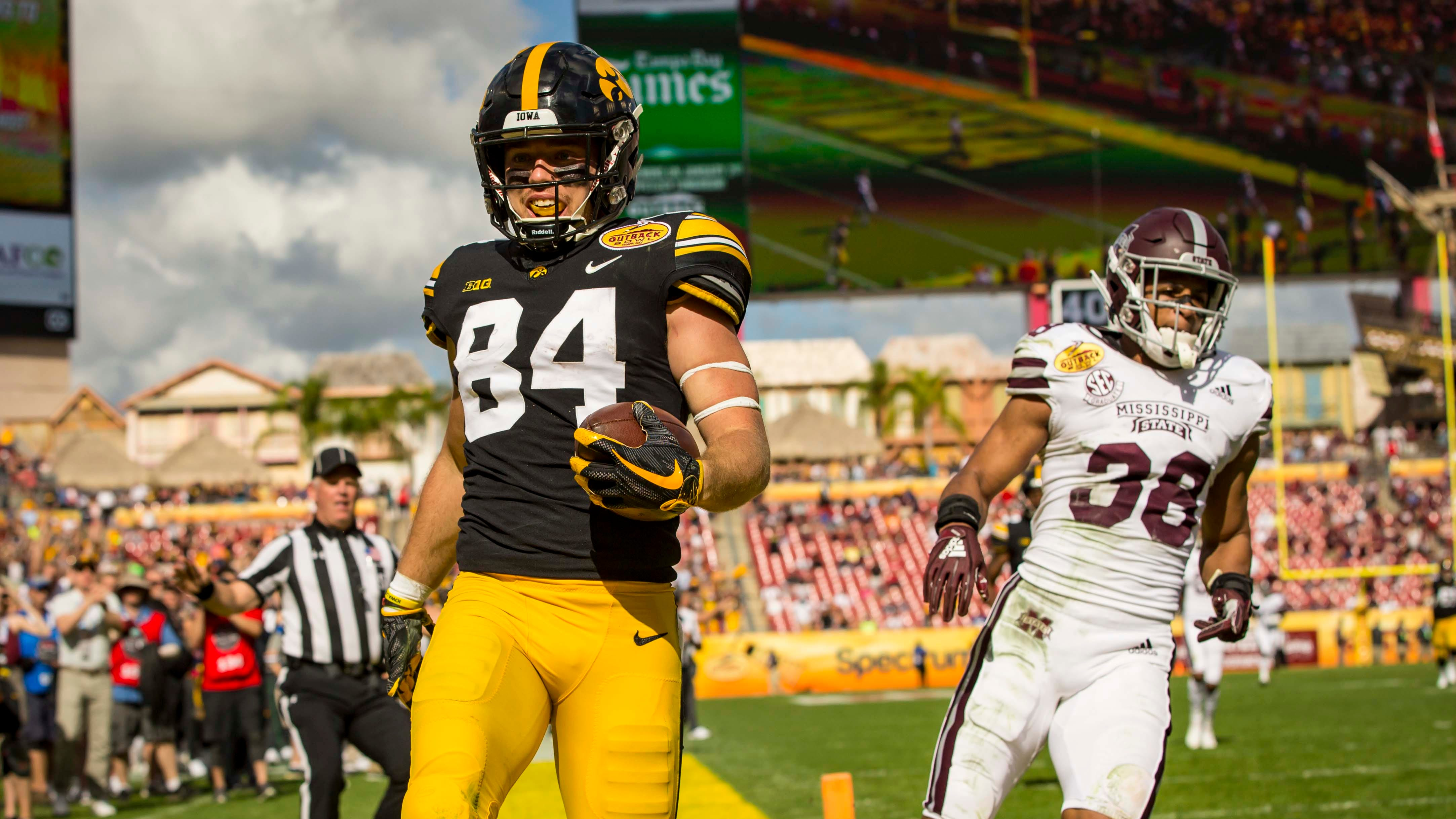 Iowa's Nick Easley scores in front of Mississippi State's Johnathan Abram in the first half at the  Outback Bowl Tues., Jan. 1, 2019, at Raymond James Stadium in Tampa, Florida. Iowa takes a 17-6 lead over Miss. St. into halftime.