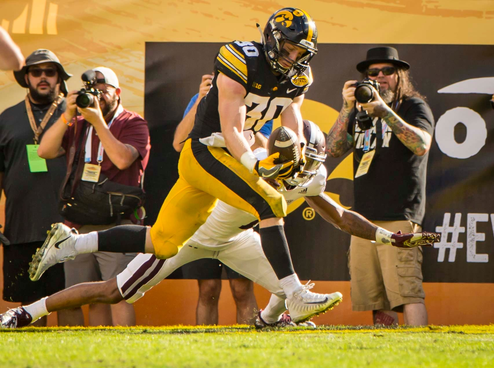 Iowa defensive back Jake Gervase intercepts a Mississippi State pass in the end zone in the second half at the Outback Bowl Tues., Jan. 1, 2019, at Raymond James Stadium in Tampa, Florida. Iowa defeated Mississippi State 27-22.