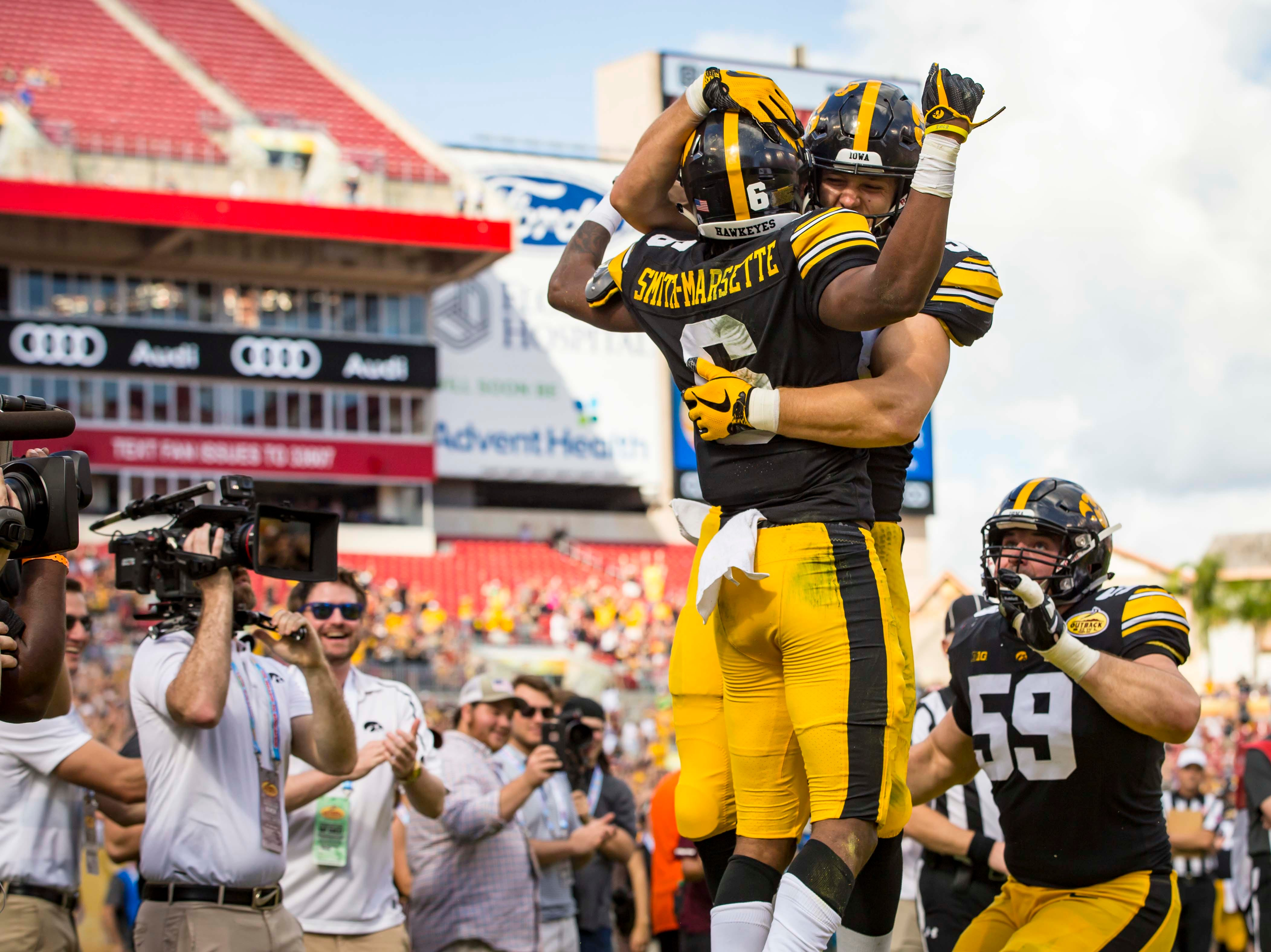 Iowa's wide receiver Ihmir Smith-Marsette celebrates a touchdown in the first half at the Outback Bowl Tues., Jan. 1, 2019, at Raymond James Stadium in Tampa, Florida. Iowa takes a 17-6 lead over Miss. St. into halftime.