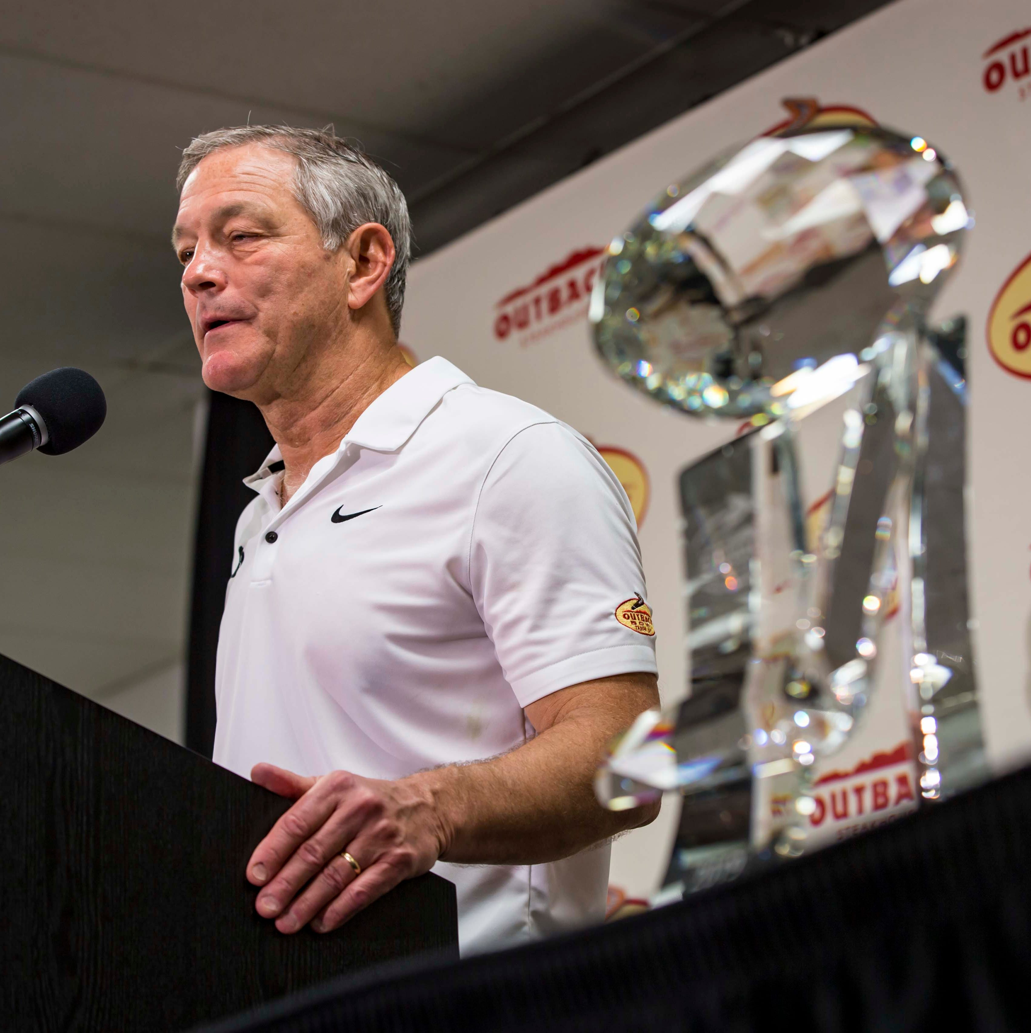 Coach Kirk Ferentz talks to media with the...
