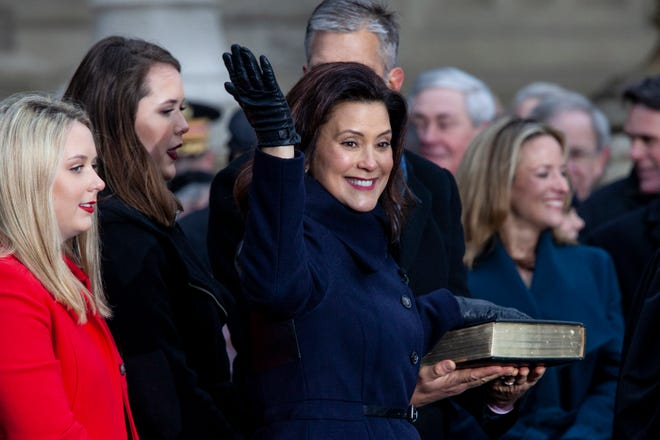 Gretchen Whitmer reacts after being sworn in as Michigan's 49th governor during the inaugural ceremonies at the Capitol  in Lansing, Mich., on Tuesday,  Jan. 1, 2019.