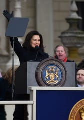 Michigan Gov. Gretchen Whitmer waves Tuesday, Jan. 1, 2019, after being sworn-in on the steps of the State Capitol in Lansing.