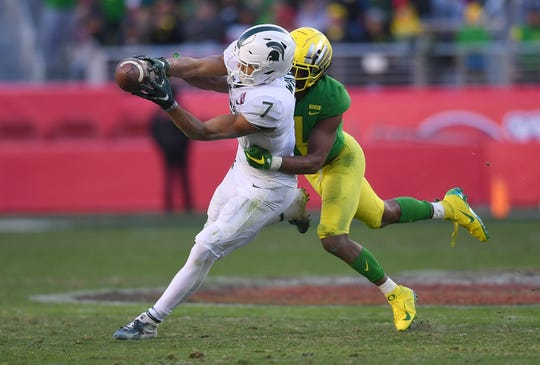 Oregon's Thomas Graham Jr. breaks up the pass to Michigan State's Cody White on fourth down late in the fourth quarter of the Redbox Bowl at Levi's Stadium on Dec. 31, 2018 in Santa Clara, Calif.