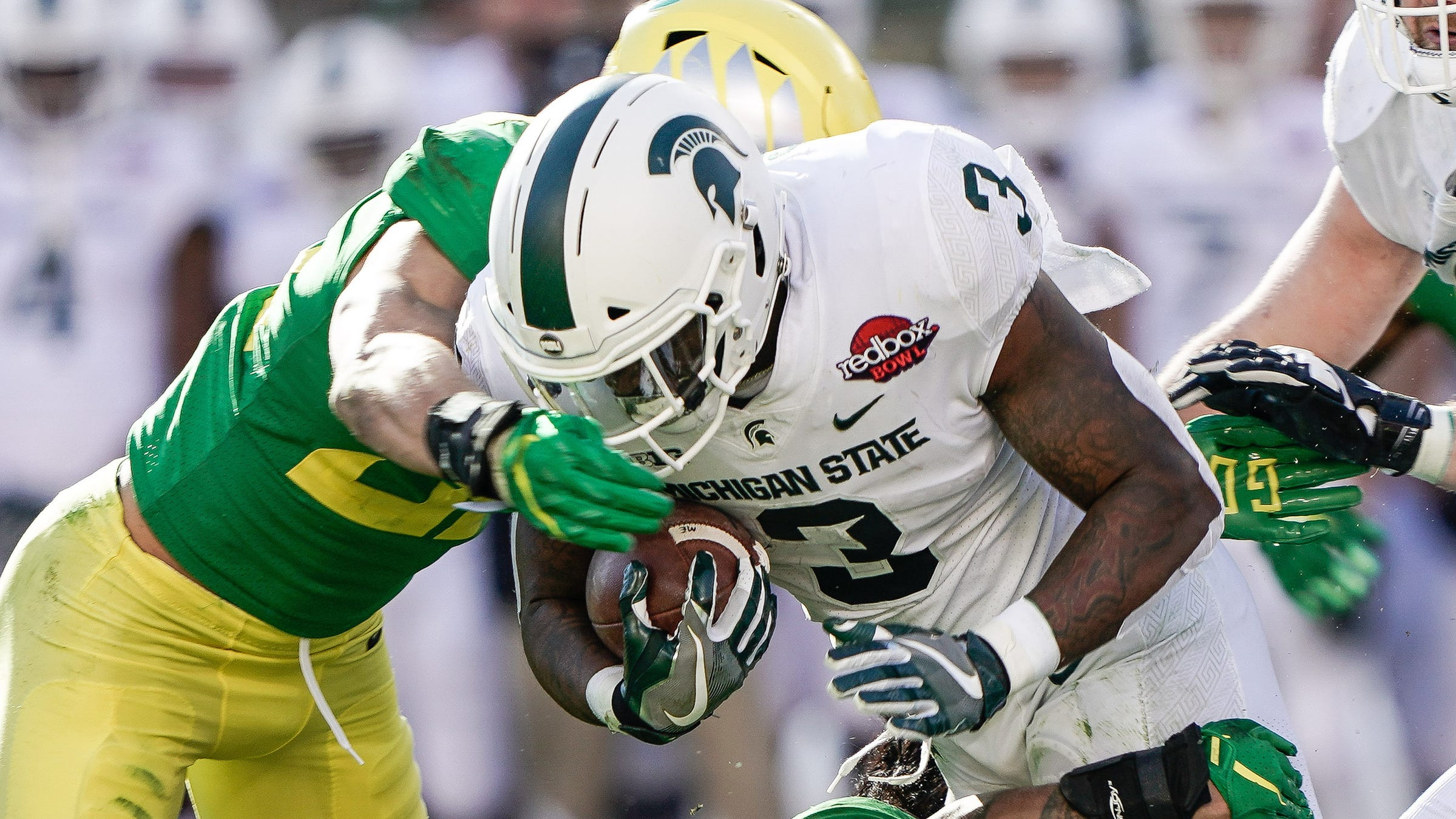 Former Michigan State football running back LJ Scott has withdrawn from the Reese's Senior Bowl due to an ankle injury.