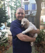 Paul N. Whelan, 48, of Novi was arrested Dec. 28, 2018, by the Russian government and accused of espionage. His family insists he's innocent, saying he was detained by mistake. In this undated photograph, he is seen holding a family dog.