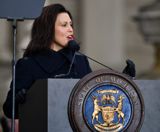Michigan Governor Gretchen Whitmer speaks Tuesday, Jan. 1, 2019, after being sworn-in as Michigan's 49th governor on the steps of the State Capitol in Lansing, Michigan.