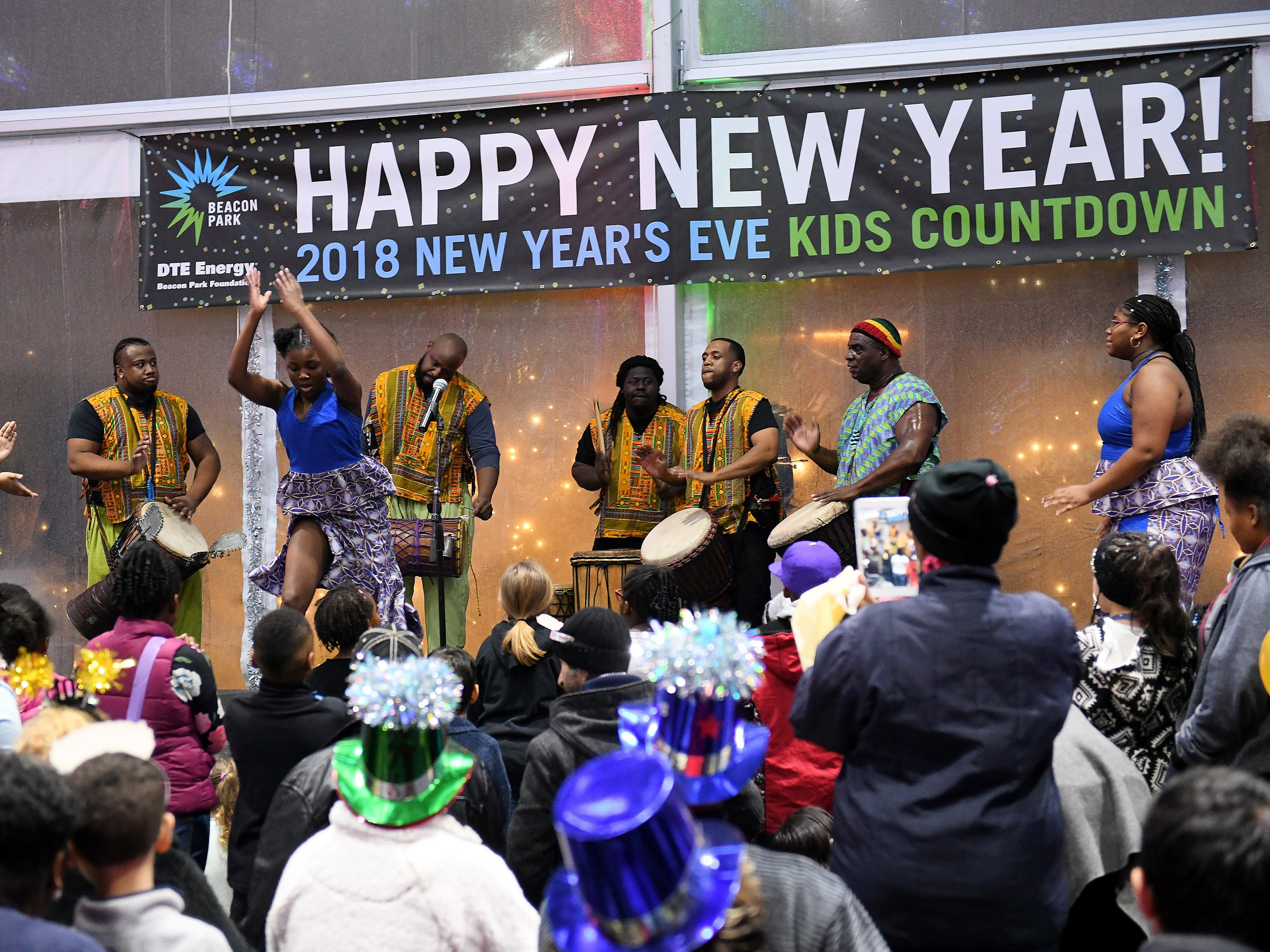 The Nanou Djiapo African drum and dance group performs at the New Year's Eve Kids Countdown at Beacon Park.