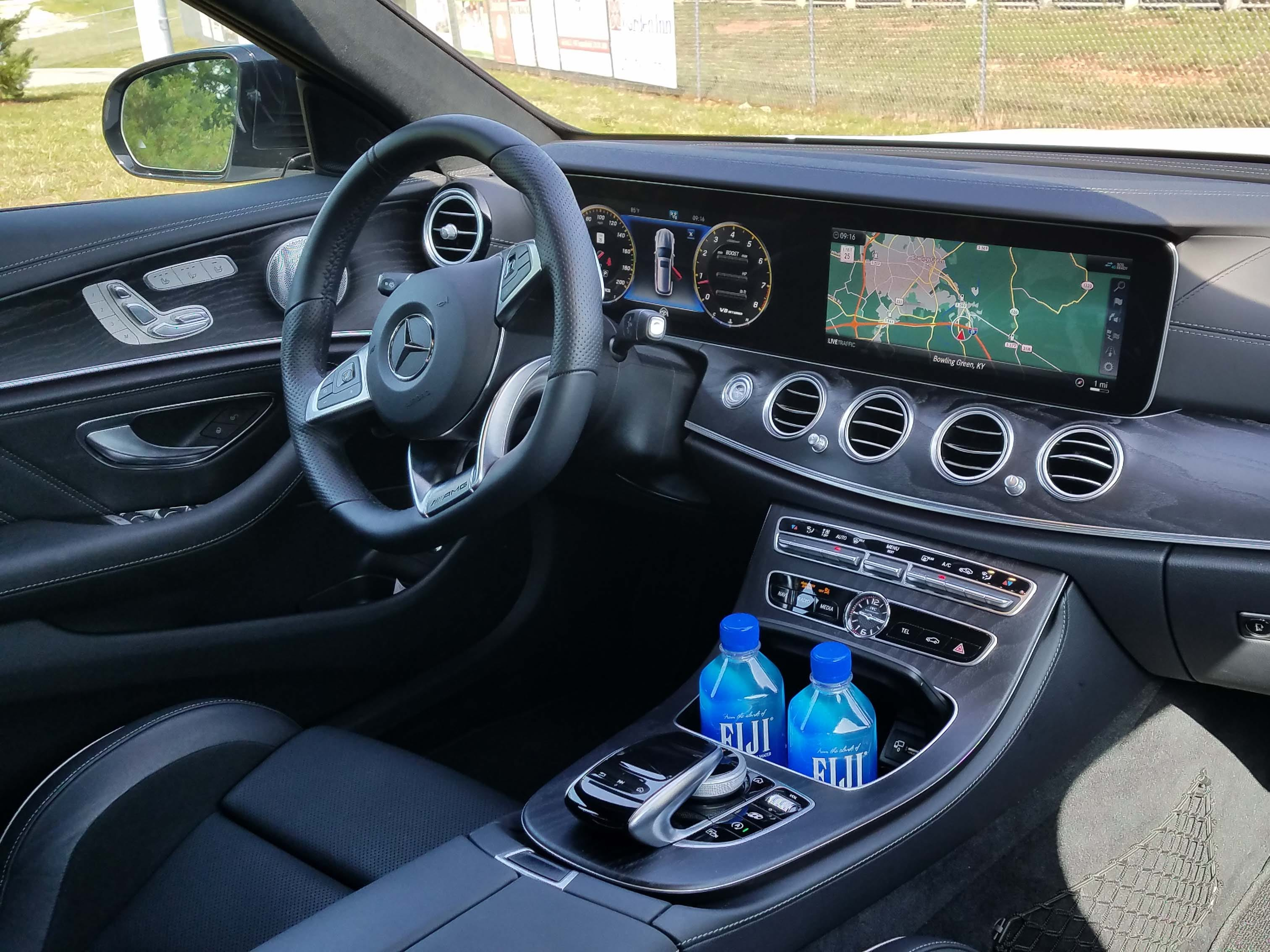 The Mercedes-AMG E63 S wagon interior is a lovely place to be with a broad digital screen, graphics, aviator-style air vents and rich wood trim.