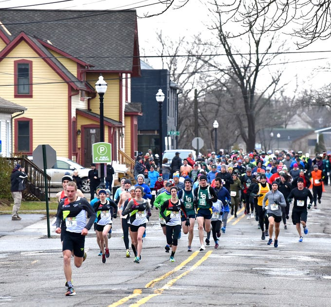 Two-hundred-sixty-registered runners participate in the New Year's Resolution Run in Lake Orion, Tuesday morning, January 1, 2019.