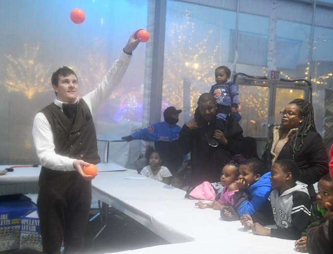 Crazy Craig the juggler, aka Craig Wise of Livonia, entertains kids and adults at the New Year's Eve Kids Countdown at Beacon Park in Detroit on Dec. 31, 2018.