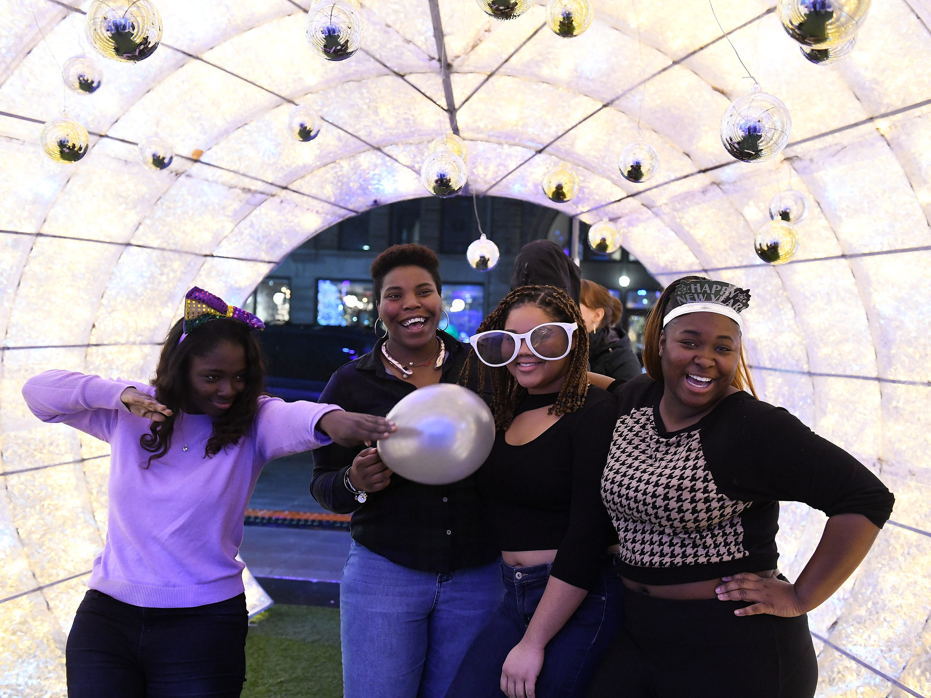 From left, Khadi Badiane, 19, Reaghan Woodfork, 19, Destiny Davis, 19, and Ophelia Joseph, 19, of Grosse Pointe pose for photos at the New Year's Eve Kids Countdow\n.