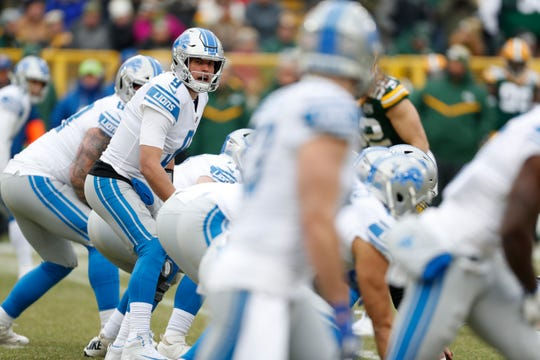 Matthew Stafford calls out signals during the Lions' final game, Sunday in Green Bay.