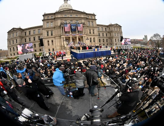 Gov/ Gretchen Whitmer takes the oath of office in front of a crowd on the steps of the Michigan Capitol in Lansing on Tuesday.
