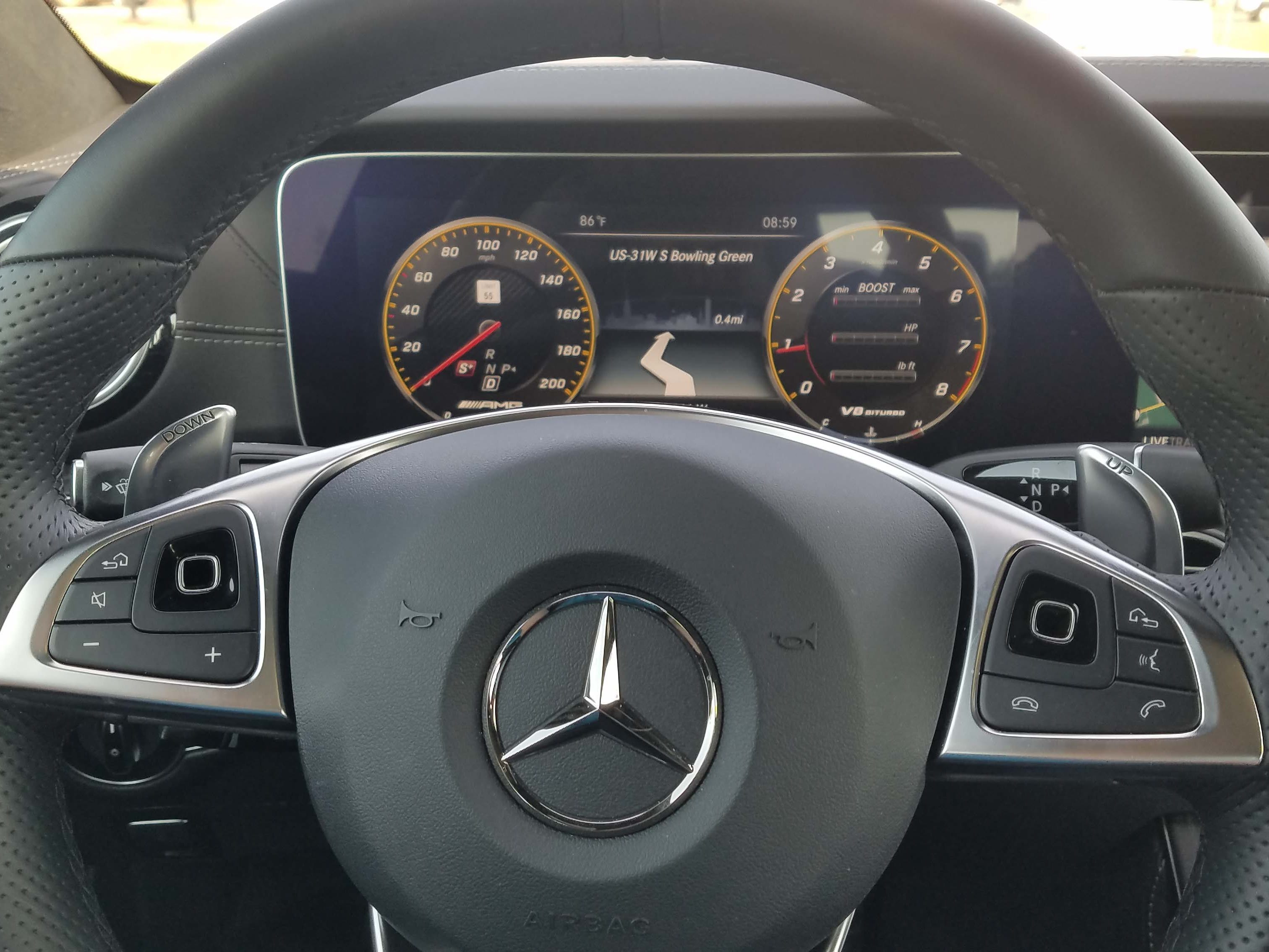 The Mercedes-AMG E63 S wagon features clever, miniature mouse pads on the steering wheel to help navigate the digital instrument display.
